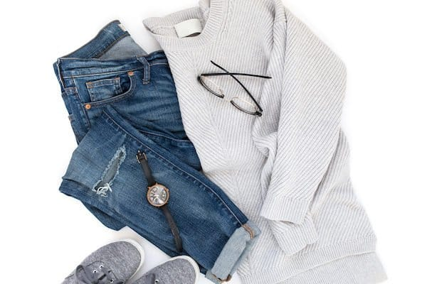 how to organize clothing with sweater, jeans, watch and shoes